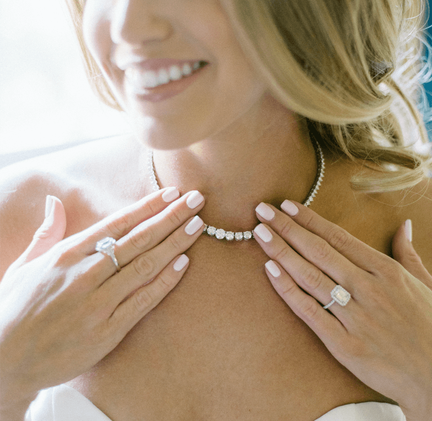 Lady smiling with wedding necklace